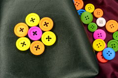 Colorful buttons on leather Royalty Free Stock Photo