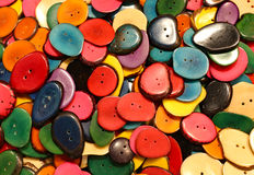 colorful  buttons madewith palm seeds dried and cut for sales in Stock Photography