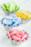 Colorful buttons in metal rustic cupcakes royalty free stock image