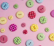 Colorful buttons pattern. Colorful bottons on pink background Royalty Free Stock Photos