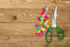 Colorful buttons and scissors Stock Photos