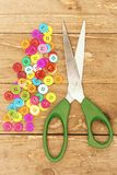 Colorful buttons and scissors Stock Photography