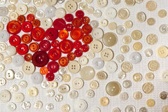 Colorful buttons in shape of heart. Red and white buttons in shape of heart Stock Photo
