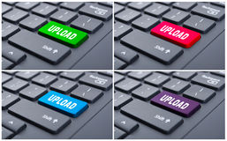 Colorful buttons with upload text. On black laptop keyboard as data transfer concept Stock Images