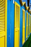 Colorful cabins and beach umbrellas by the sea.  stock images