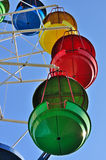 Colorful cabins of ferris wheel against the blue sky Stock Image