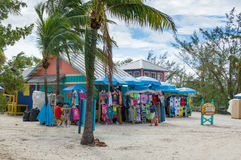 Colorful cabins, tower, palm trees and sand Stock Image