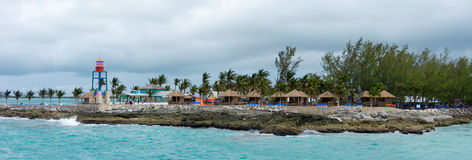 Colorful cabins, tower, and palm treesin the Bahamas Royalty Free Stock Photo