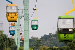 Colorful cable car hanging. Photo of colorful cable car hanging in the sky Stock Photos