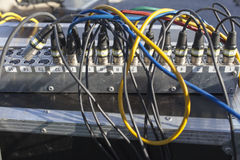Colorful cables on Audio mixing board Stock Image