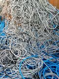Colorful cables and wires as background. Industrial scrap Royalty Free Stock Image