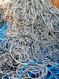 Colorful cables and wires as background. Industrial scrap Royalty Free Stock Photos