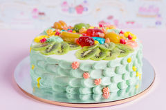 Colorful cake with fruit and candies for kids party Royalty Free Stock Images