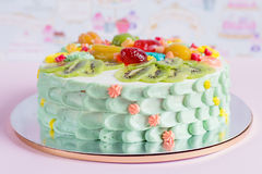 Colorful cake with fruit and candies for kids party Stock Images