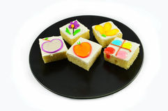 Colorful cake on plate Stock Image