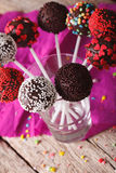 Colorful cake pops with candy sprinkles close up in a glass. ver Stock Photos