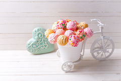 Colorful cake pops  in decorative bicycle and turquoise heart  o Royalty Free Stock Photography