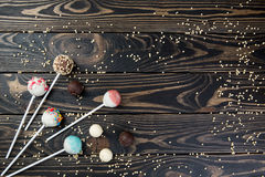 Colorful cake pops set on wooden background for text. Celebration cake pops on tabe for text typing Royalty Free Stock Image