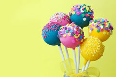 Colorful cake pops. On a yellow background Stock Images