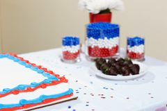 Colorful cake among sweet food on table royalty free stock photos