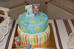 Colorful cake with toy bears and candle with the words written in Ukrainian - `My first year` stock image