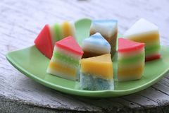 Colorful Cakes. Sweet and colorful layer cakes displayed in green plate stock photos