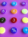 Colorful calculator. Calculator with the focus on the three , shallow depth of field Royalty Free Stock Photo