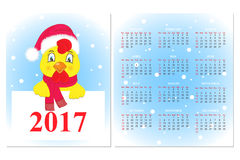 Colorful Calendar 2017 with a rooster in a Santa Claus hat and scarf.  Stock Photos