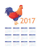 Colorful 2017 calendar with rooster - symbol of the year. Colorful 2017 calendar with cartoon rooster - symbol of year, vector illustration isolated on white Royalty Free Stock Images