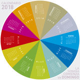 Colorful calendar for 2018 in Spanish. Circular design. Week starts on Sunday Royalty Free Stock Image