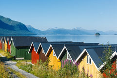 Colorful camping cabins on the fjord shore Royalty Free Stock Image