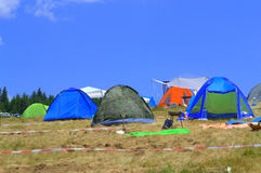 Colorful camping tents on mountain meadow Royalty Free Stock Images