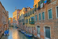 Colorful Canal in Venice. A typical canal in Venice with beautifully colored houses Royalty Free Stock Photo