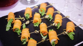 Colorful canapes are on the black tray stock footage