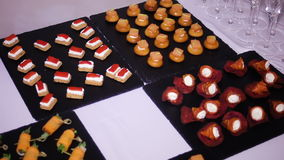 Colorful canapes are on the black tray stock video footage