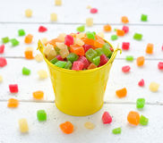 Colorful candied fruits in a small bucket Stock Images