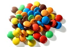 Colorful candies. Lots of colorful candies spread on white background Stock Photo