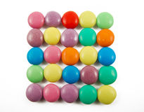 Colorful candies. Lots of colorful candies isolated on white background stock photo