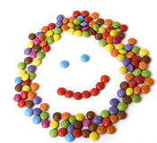 Colorful candies. Made in kid face shape isolated on white background Stock Images