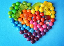 Colorful candies arranged as heart on background Stock Photography