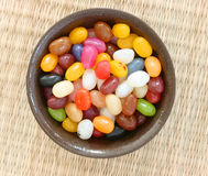Colorful candies in brown bowl Royalty Free Stock Photos