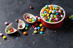 Colorful candies and chocolate egg Royalty Free Stock Image