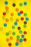 Colorful candies close up. On the yelow background Royalty Free Stock Images