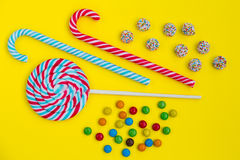 Colorful candies close up. On the yelow background Stock Image