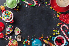 Colorful candies and coffee cup frame Stock Photo