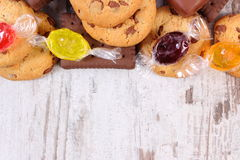 Colorful candies and cookies, copy space for text, too many sweets Stock Photo