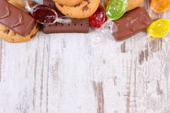 Colorful candies and cookies, copy space for text, too many sweets Stock Images