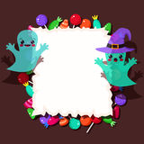Colorful candies and cute Halloween ghosts with frame Royalty Free Stock Image