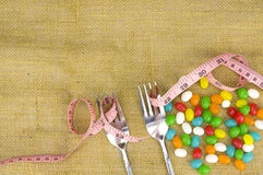 Colorful candies fork and tape measure Stock Image