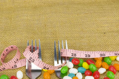 Colorful candies fork and tape measure Royalty Free Stock Photos